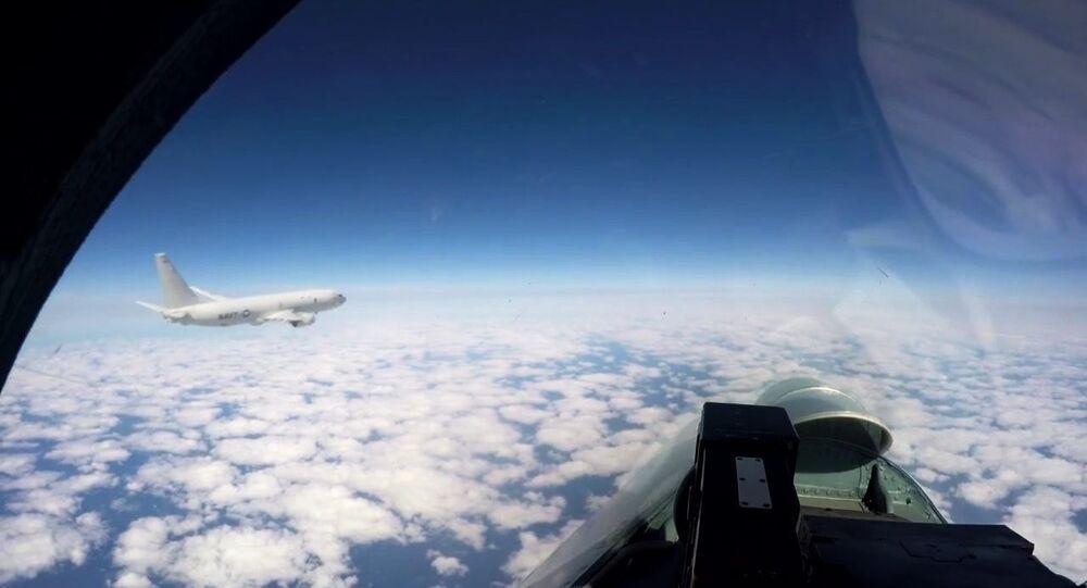 Russian fighter Su-27 escorts the US Navy base patrol aircraft P-8A Poseidon