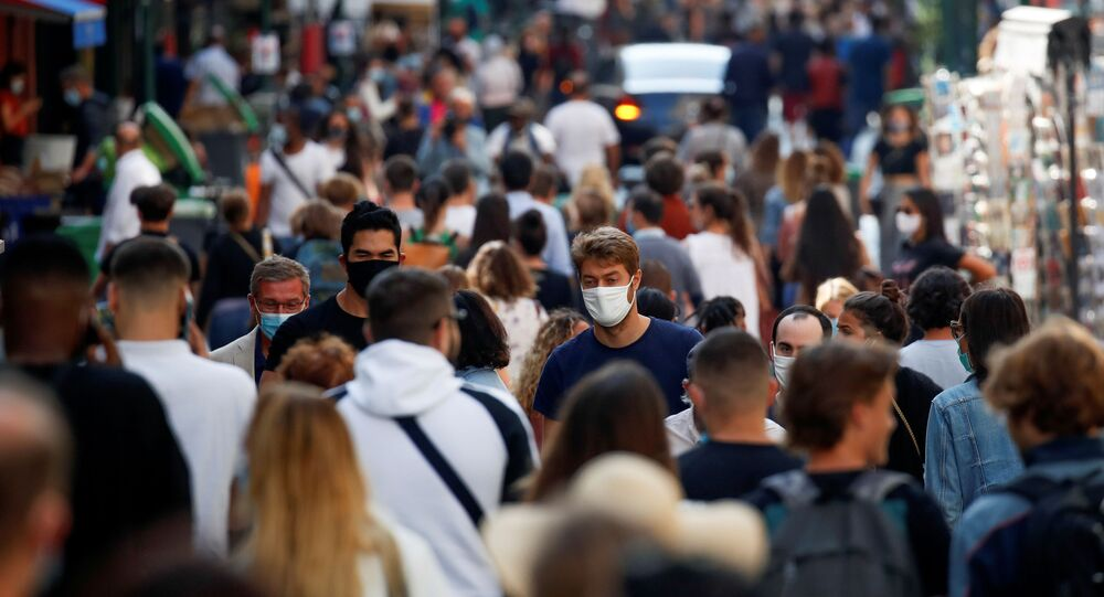 People wearing protective face masks walk in a busy street in Paris as France reinforces mask-wearing in public places as part of efforts to curb a resurgence of the coronavirus disease (COVID-19) across France, September 18, 2020.