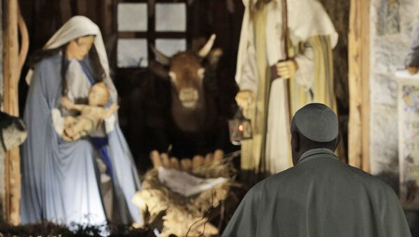 In this Dec. 31, 2019 file photo, Pope Francis stops by the Nativity exposed in St. Peter's square after presiding over vespers of the Feast of St. Mary and Te Deum of Thanksgiving at year's end, in St. Peter's Basilica at the Vatican. - Sputnik International