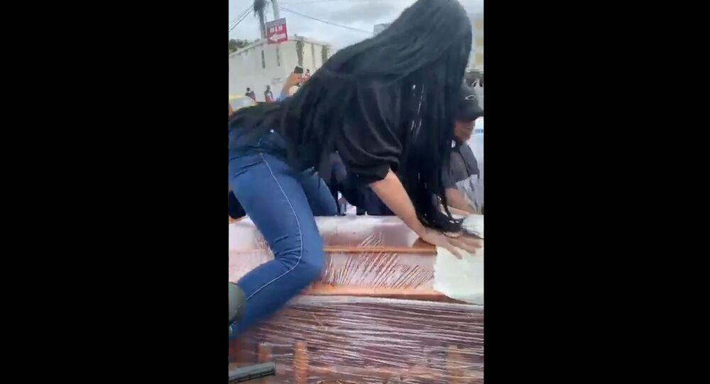 Woman twerking on top of her boyfriend's coffin