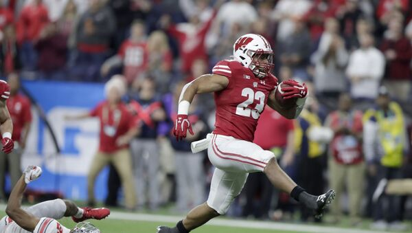 FILE - In this Dec. 7, 2019, file photo, Wisconsin running back Jonathan Taylor (23) runs for a touchdown past Ohio State cornerback Shaun Wade (24) during the first half of the Big Ten championship NCAA college football game, in Indianapolis. Taylor was selected to The Associated Press All-Big Ten Conference team, Wednesday, Dec. 11, 2019. (AP Photo/Michael Conroy, File) - Sputnik International