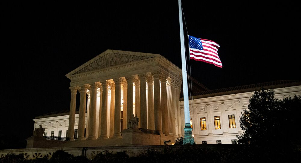 The American flag flies at half staff following the death of U.S. Supreme Court Justice Ruth Bader Ginsburg, outside of the U.S. Supreme Court, in Washington, U.S., September 18, 2020.