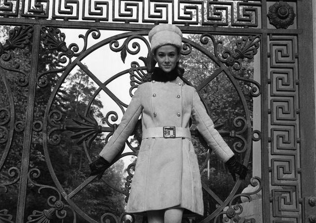 A model demonstrates a coat from the 1968 autumn-winter collection at the Moscow House of Fashion, August 1967
