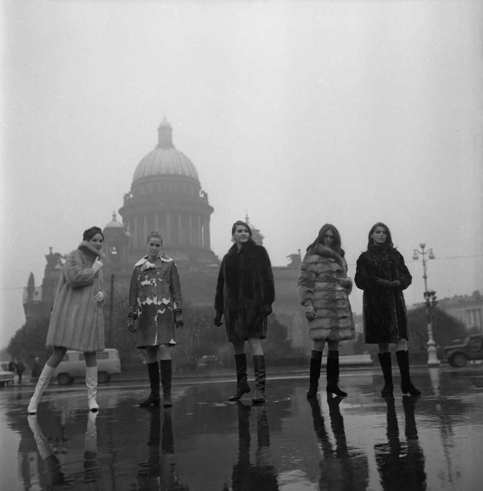 Models demonstrate fur coats from the 1968-1969 collection near the St Isaac Cathedral in Leningrad, October 1968