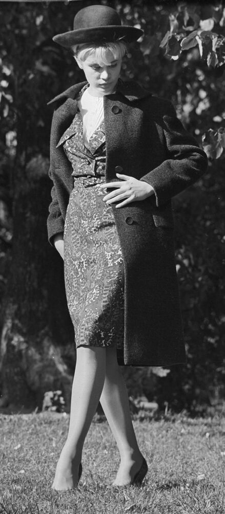 A model demonstrates a dress made of artificial silk, a wool coat and a felt hat - all from the 1964 autumn collection.