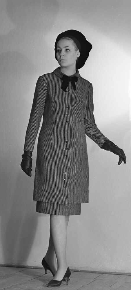 A model demonstrates a wool costume from the spring-autumn collection, 1965