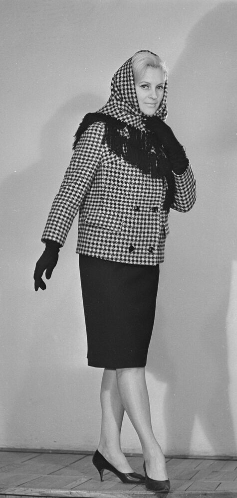 A model demonstrates a jacket and a shawl from the 1965 autumn collection