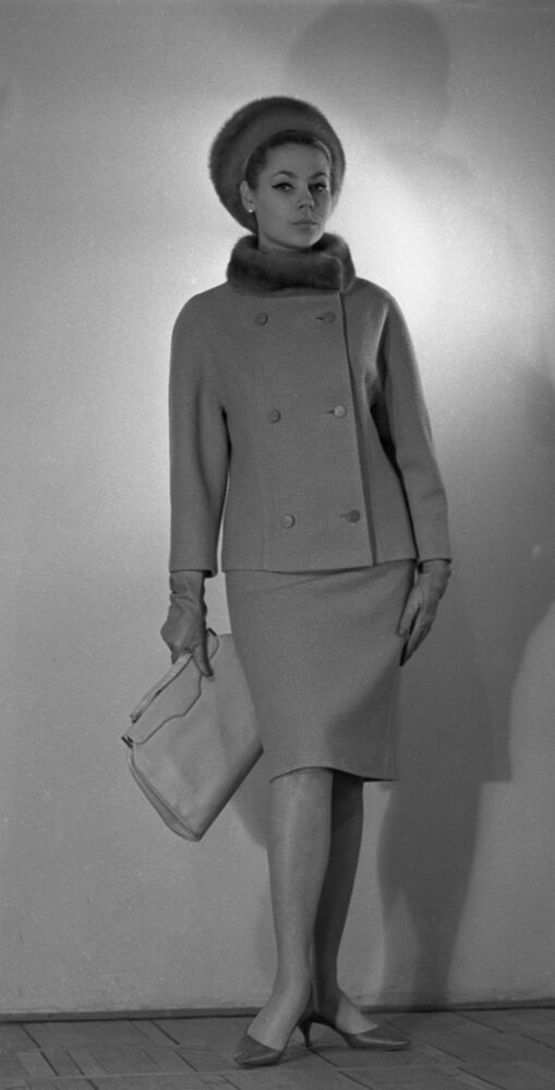 A model demonstrates a coat and a fur hat from the autumn-winter collection of 1965