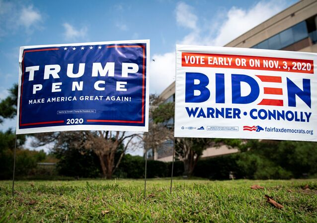 Yard signs supporting U.S. President Donald Trump and Democratic U.S. presidential nominee and former Vice President Joe Biden are seen outside of an early voting site at the Fairfax County Government Center in Fairfax, Virginia, U.S., September 18, 2020.