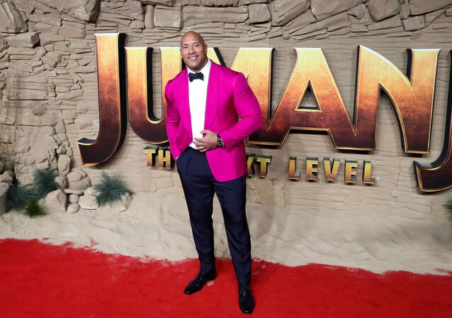Actor Dwayne Johnson poses as he arrives to the premiere of Jumanji: The Next Level in London, Britain December 5, 2019.
