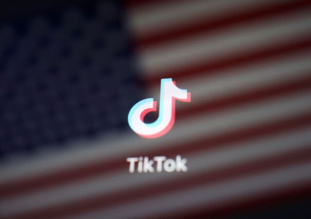 A reflection of the U.S. flag is seen on the sign of the TikTok app in this illustration picture taken September 19, 2020.