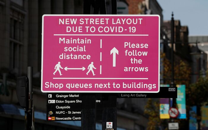 A social distancing sign is seen amid the spread of the coronavirus disease (COVID-19) in Newcastle, Britain, September 18, 2020.