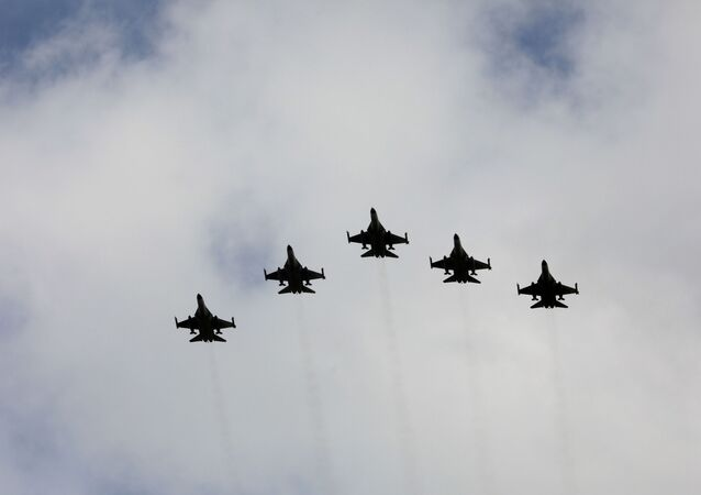Taiwanese F-16 fighter jets fly in formation during an inauguration ceremony in Taichung, Taiwan, August 28, 2020.