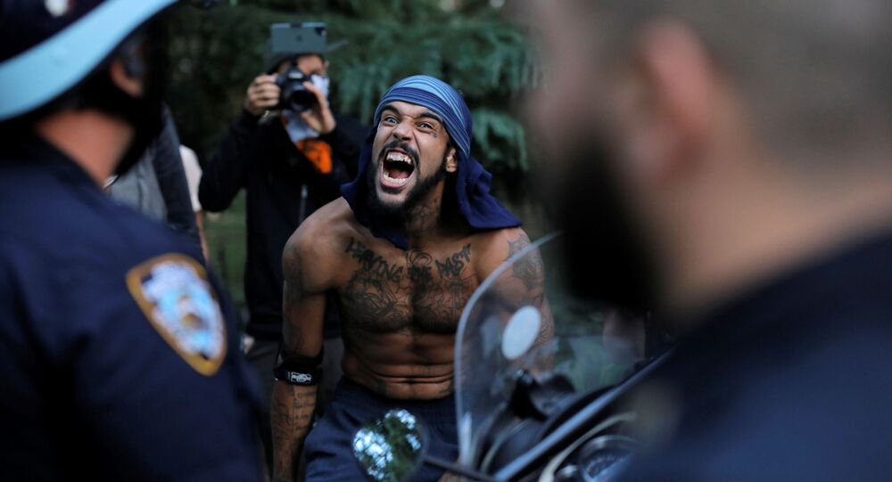 U.S. Justice Dept weighs stripping federal funds from cities allowing 'anarchy'