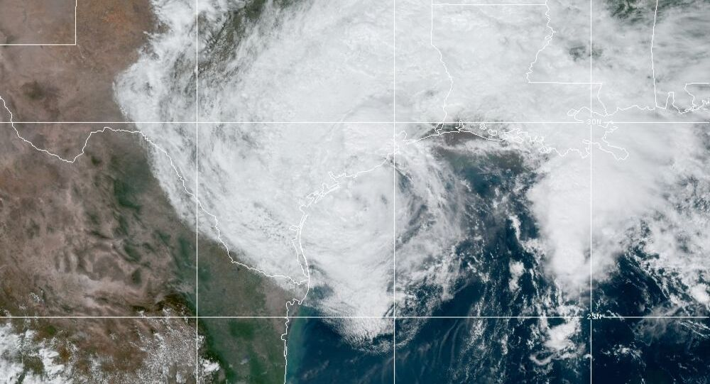 This GOES-16 GeoColor satellite image taken Monday, Sept. 21, 2020, and provided by NOAA, shows Tropical Storm Beta, center, in the Gulf of Mexico.