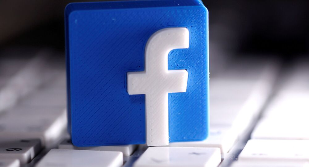 A 3D-printed Facebook logo is seen on a keyboard in this illustration taken March 25, 2020.