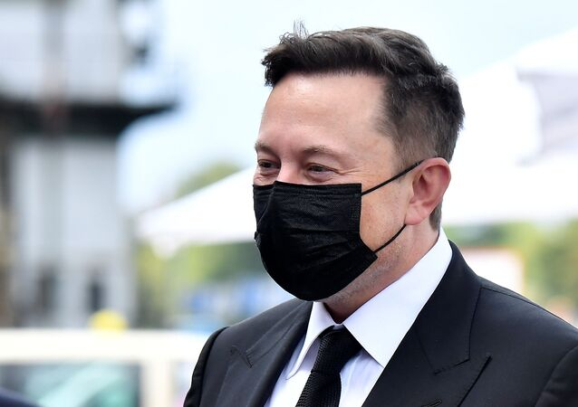 Elon Musk wears a protective mask as he arrives to attend a meeting with the leadership of the conservative CDU/CSU parliamentary group, in Berlin, Germany September 2, 2020.
