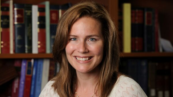 U.S. Court of Appeals for the Seventh Circuit Judge Amy Coney Barrett, a law professor at Notre Dame  University, poses in an undated photograph obtained from Notre Dame University September 19, 2020. - Sputnik International