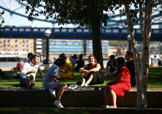 People sit in a park, as the spread of coronavirus disease (COVID-19) continues, in London, Britain, 14 September 2020