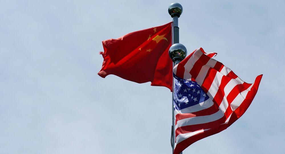 Chinese and U.S. flags flutter near the Bund in Shanghai, China July 30, 2019