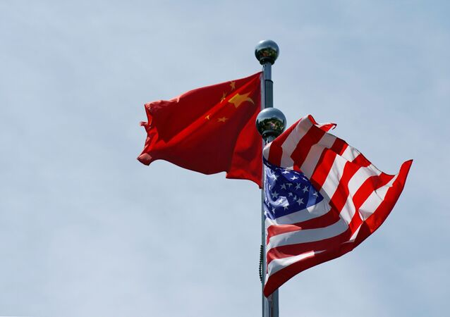 Chinese and U.S. flags flutter near the Bund in Shanghai, China, 30 July 2019