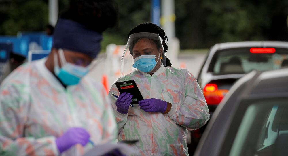 Medical technicians work at a drive-through coronavirus disease (COVID-19)