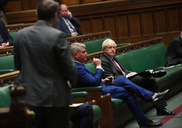 Britain's Prime Minister Boris Johnson looks on during a PM's statement session on the coronavirus disease (COVID-19) in the House of Commons, in London, Britain September 22, 2020.