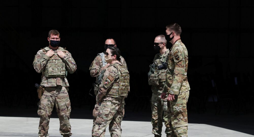 U.S. troops stand guard during a handover ceremony of A-29 Super Tucano planes from U.S. to the Afghan forces, in Kabul, Afghanistan September 17, 2020