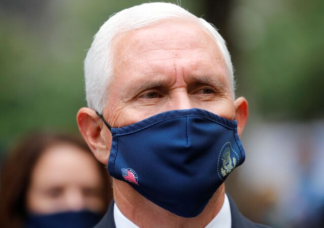 U.S. Vice President Mike Pence wears a protective face mask because of the coronavirus disease (COVID-19) pandemic as he attends ceremonies marking the 19th anniversary of the September 11, 2001 attacks on the World Trade Center at the 911 Memorial & Museum in New York City, New York, U.S., September 11, 2020