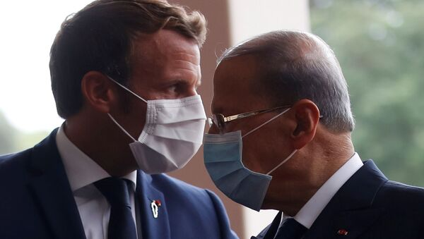 French President Emmanuel Macron and Lebanon's President Michel Aoun wear face masks as they arrives to attend a meeting at the presidential palace in Baabda, Lebanon September 1, 2020.  - Sputnik International