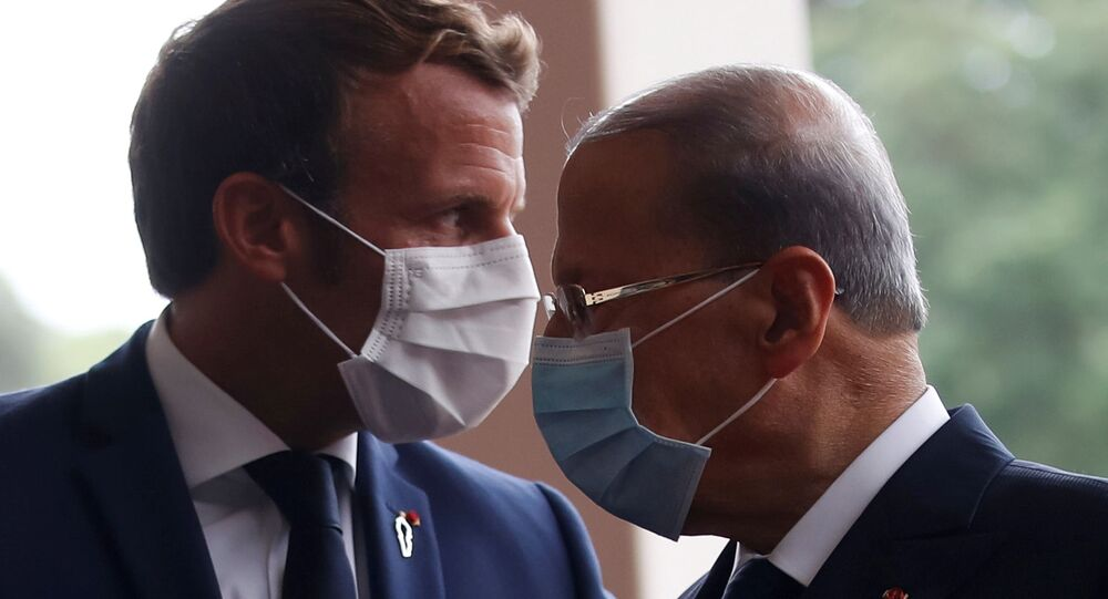French President Emmanuel Macron and Lebanon's President Michel Aoun wear face masks as they arrives to attend a meeting at the presidential palace in Baabda, Lebanon September 1, 2020.