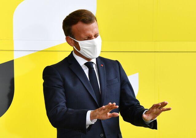 Cycling - Tour de France - Stage 17 - Grenoble to Meribel Col De La Loze - France - September 16, 2020. French President Emmanuel Macron gestures
