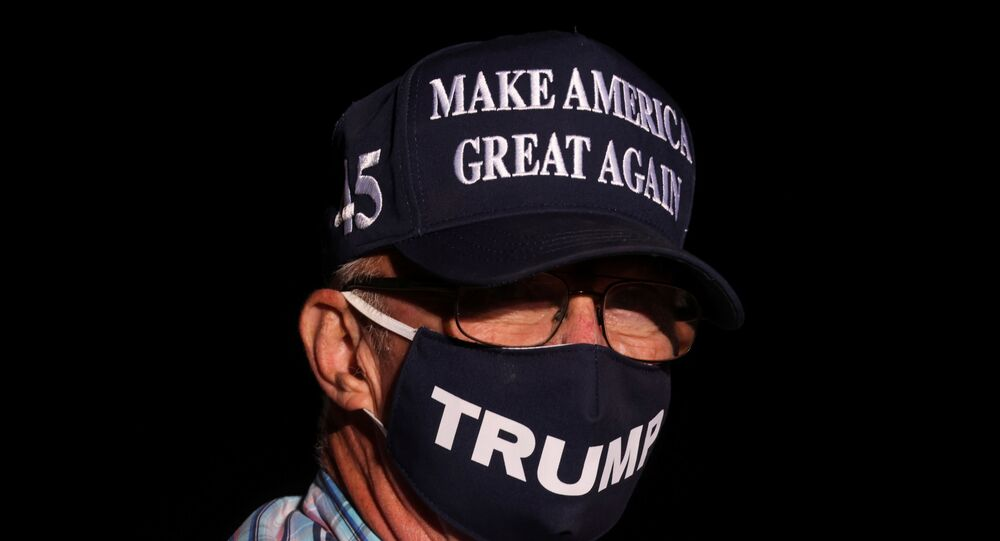A man wearing a Make America Great Again hat attends U.S. President Donald Trump's campaign rally in Reno, Nevada, U.S., September 12, 2020.