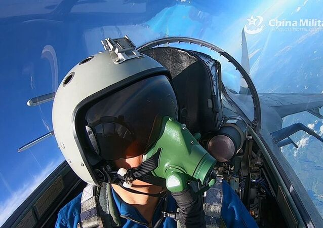 A video snapshot shows a pilot assigned to an aviation brigade of the air force under the PLA Eastern Theater Command navigates his fighter jet to make a turn in level flight during a round-the-clock flight training exercise on September 17, 2020. Airmen with the aviation brigade fully studied the changes in weather, bird activity, equipment performance and other aspects brought about by seasonal changes, so as to practice the basic skills of aerial combat to the best