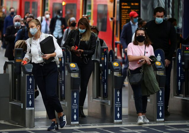 People wearing protective face masks make their way through Waterloo station during the morning rush hour, amid the coronavirus disease (COVID-19) outbreak, in London, Britain, September 23, 2020