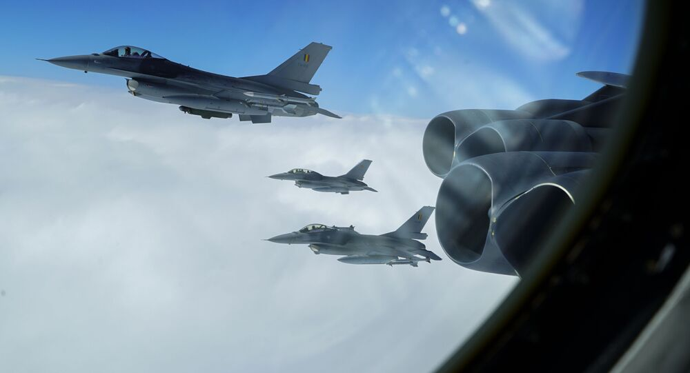Belgian F-16A Fighting Falcons join up in formation alongside a B-52H Stratofortress, assigned to the 5th Bomb Wing at Minot Air Force Base, North Dakota, during the Bomber Task Force Europe mission, Allied Sky, on Aug. 28, 2020. Allied Sky was a single-day mission overflying 30 NATO nations and part of the routine Bomber Task Force missions that have occurred in the European theater of operations since 2018 with more than 200 sorties coordinated with Allies and partners.