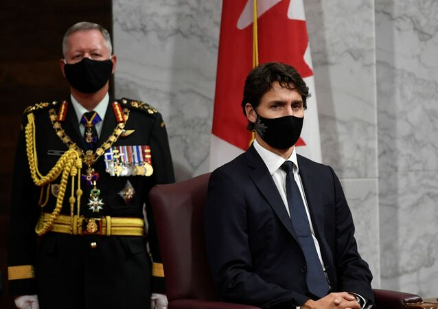 Chief of Defence Staff Jonathan Vance and Prime Minister Justin Trudeau listen to Canada's Governor General Julie Payette delivering the throne speech in the Senate chamber in Ottawa, Ontario, Canada September 23, 2020.