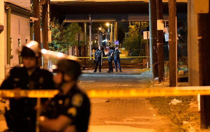 Police officers guard the location near where an officer was been shot, after protesters clashed with police after a grand jury considering the March killing of Breonna Taylor, a Black medical worker, in her home in Louisville, Kentucky, voted to indict one of three white police officers for wanton endangerment, in Louisville, Kentucky, U.S. September 23, 2020