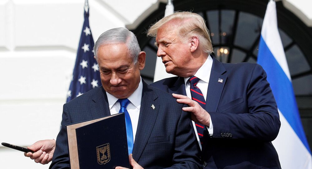 Israel's Prime Minister Benjamin Netanyahu stands with U.S. President Donald Trump after signing the Abraham Accords, normalizing relations between Israel and some of its Middle East neighbors,  in a strategic realignment of Middle Eastern countries against Iran, on the South Lawn of the White House in Washington, U.S., September 15, 2020