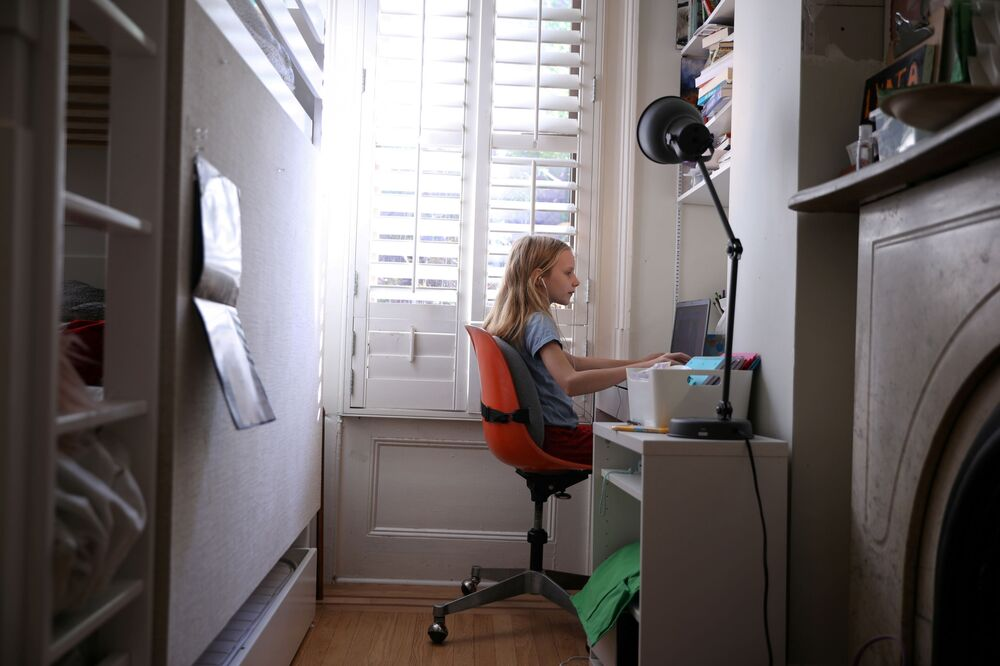 Due to the coronavirus, many countries have switched to distance learning. In the photo, a girl is listening to a lesson while sitting at home at her computer in Brooklyn, New York, US.
