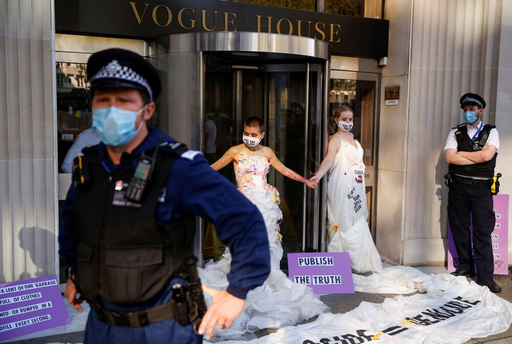 Masked protests. A group of civil society activists in London are holding a rally outside the world famous publishing house Conde Nast, demanding to protect the principles of free speech.