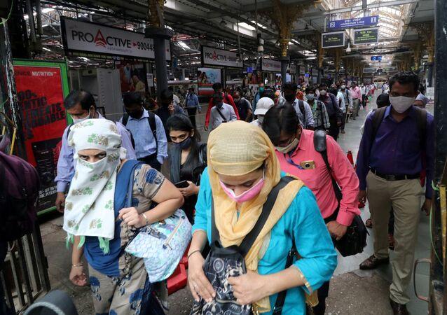 People wearing protective face masks leave the Chhatrapati Shivaji Terminus railway station, amidst the coronavirus disease (COVID-19) outbreak, in Mumbai, India, September 22, 2020