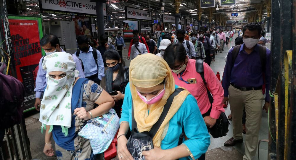 People wearing protective face masks leave the Chhatrapati Shivaji Terminus railway station, amidst the coronavirus disease (COVID-19) outbreak, in Mumbai, India, 22 September 2020