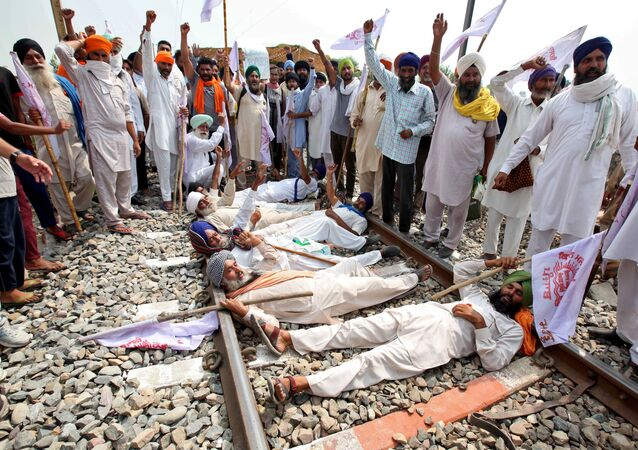 Farmers shout slogans as they block a railway track during a protest against farm bills passed by India's parliament, in Devi Dasspura village on the outskirts of Amritsar, India, September 24, 2020