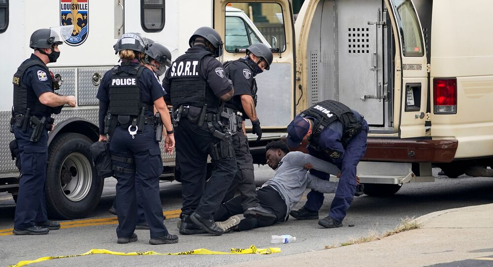 Police officers detain a protester, as people react after a decision in the criminal case against police officers involved in the death of Breonna Taylor, who was shot dead by police in her apartment, in Louisville, Kentucky, U.S. September 23, 2020