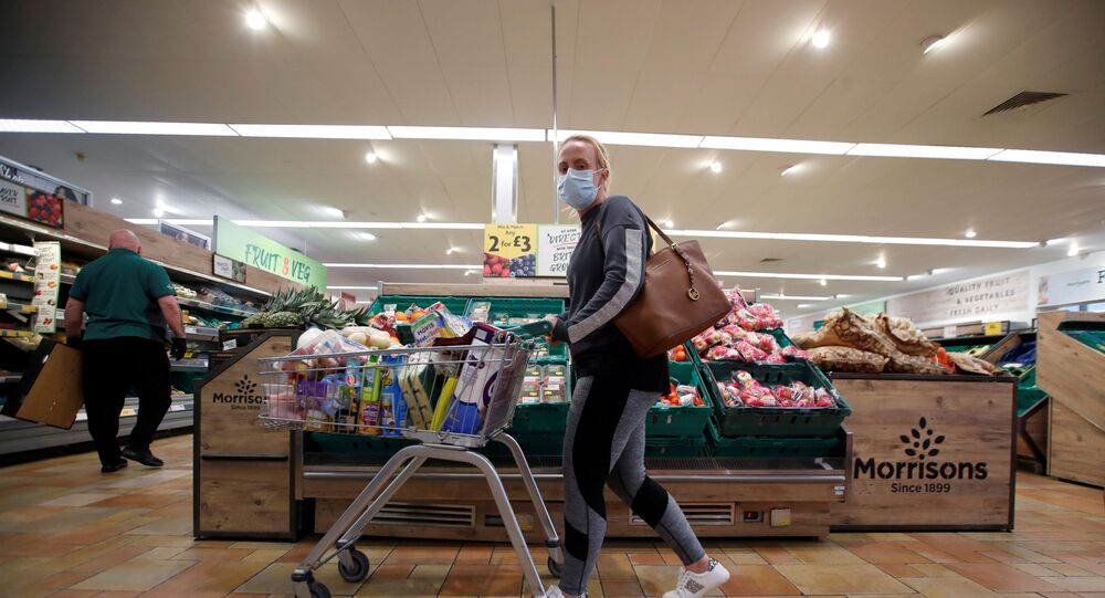 A customer wearing a protective face mask shops at a Morrisons store in St Albans, Britain, September 10, 2020.