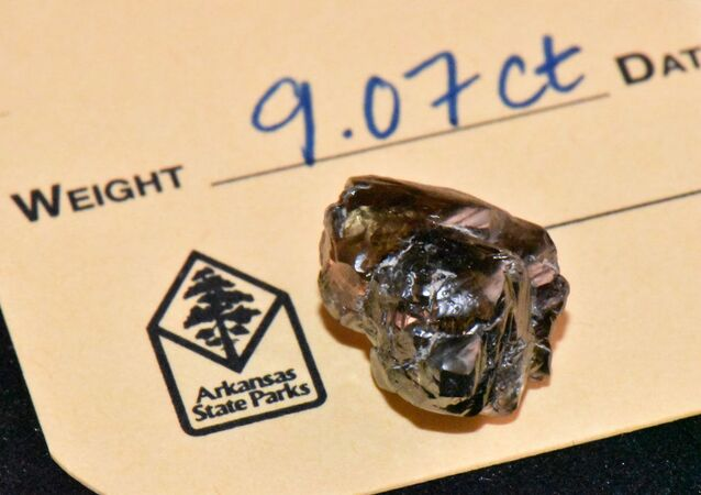 Image provided by the Arkansas State Parks offers closeup view of the Kinard Friendship Diamond, along with an official state park tag indicating its official weight and documentation by park officials.