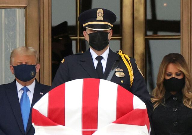 U.S. President Donald Trump and First Lady Melania Trump pay their respects to late Associate Justice Ruth Bader Ginsburg as her casket lies in repose at the top of the steps of the U.S. Supreme Court building in Washington, U.S., September 24, 2020. REUTERS/Jonathan Ernst     TPX IMAGES OF THE DAY