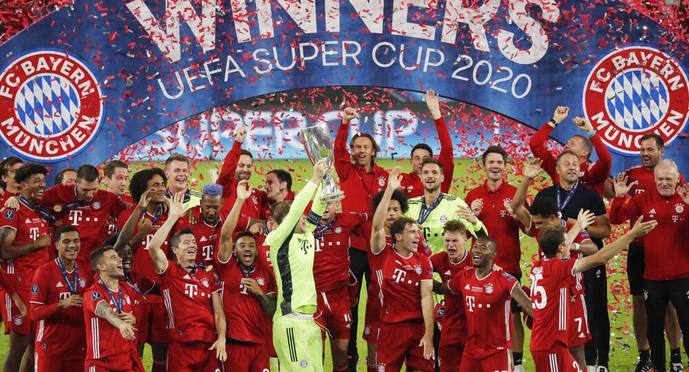 Soccer Football - European Super Cup - Bayern Munich v Sevilla - Puskas Arena, Budapest, Hungary - September 24, 2020.  Bayern Munich celebrate with the trophy after winning the European Super Cup