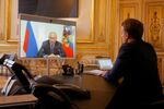 French President Emmanuel Macron listens to Russian President Vladimir Putin during a video conference at the Elysee Palace in Paris, France, June 26, 2020.